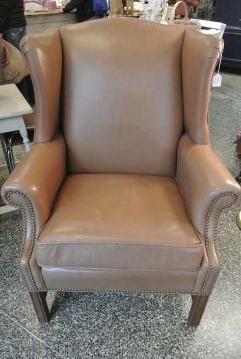 Brown leather wingback chair. $350