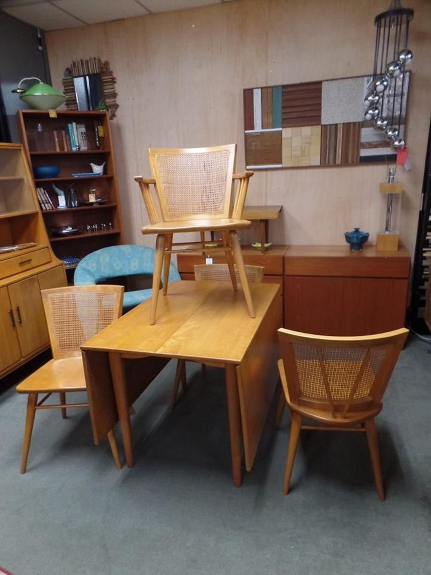 Set of four Mid Century Modern solid birch dining chairs with cane backs  from the. Conant Ball from furniture stores in Washington DC  Baltimore