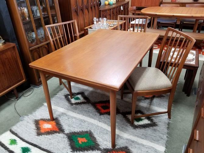 Danish Modern teak draw leaf dining table