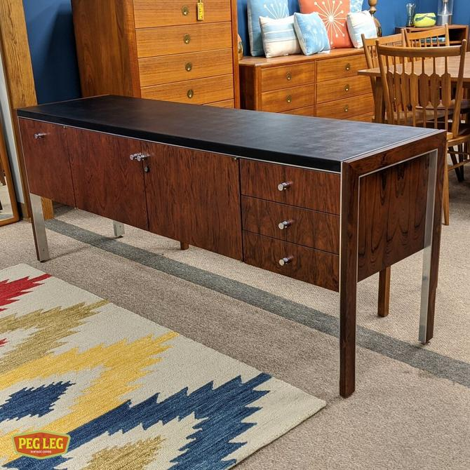 Rosewood credenza with leather top by Herman Miller for Biltrite.