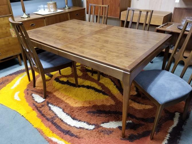 Mid-Century Modern walnut dining table with 2 18 inch leaves