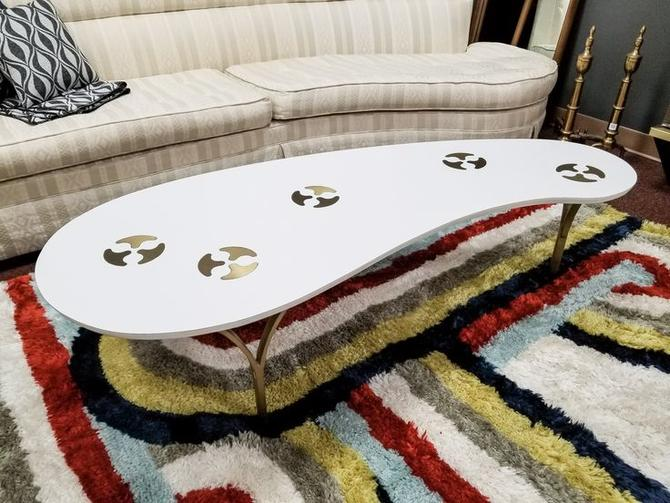 Mid-Century Modern amorphic coffee table with brass inserts and legs