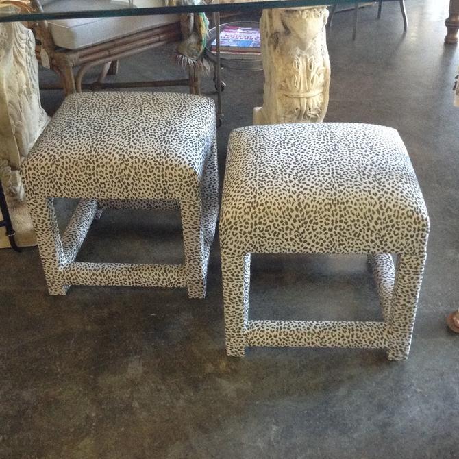 Pair of upholstered vintage ottomans
