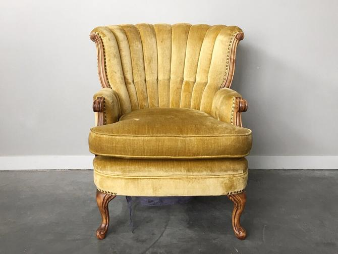 vintage plush gold channel back chair.