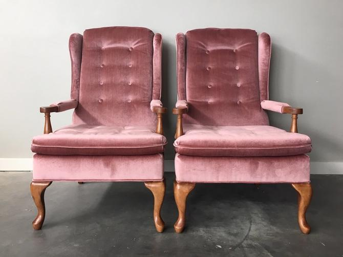 pair of vintage wingback chairs in plush pink.