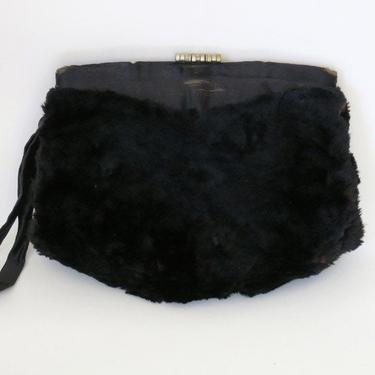 1940s or 50s real fur clutch with unique clasp by flutterandecho