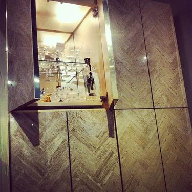 Vintage Ello Bar cabinet with herringbone travertine inlay.