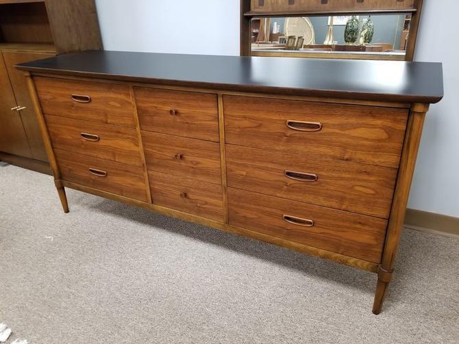 Mid-Century Modern walnut nine drawer dresser with black top