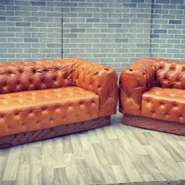 Vintage Chesterfield Sofa and Loveseat Newly Upholstered in a Button Tufted Leather on a Four Sided Oak Base - 2 Piece Set