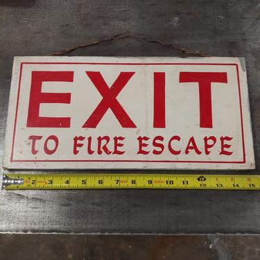 Hand painted wood exit to fire escape sign