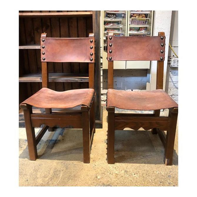 Pair of brown leather chairs 33 B x 16 D x 17.5 seat