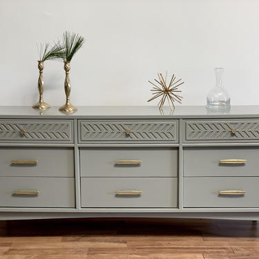 SOLD         MCM mid century dresser with grey lacquer and polished brass hardware by McKennaDesignCompany