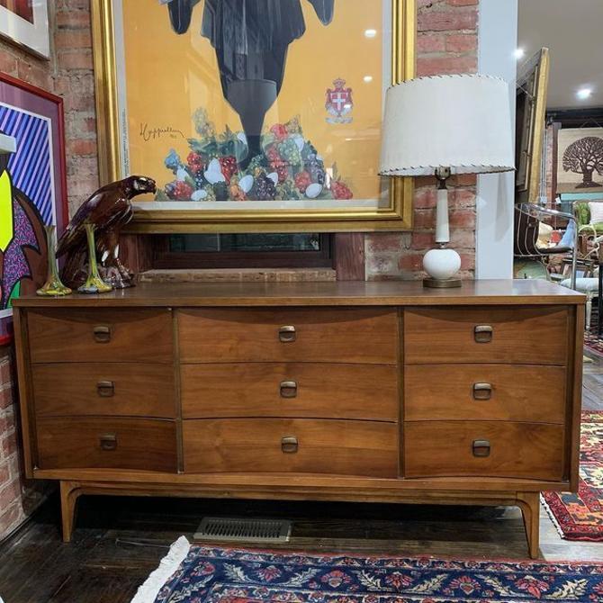 Johnson Carper curved front lowboy dresser, 9 drawers, laminate top