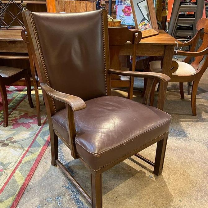 """Brown leather armchair, seat 23""""W x 22""""L"""