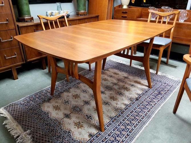 Mid-Century Modern walnut boat shape dining table