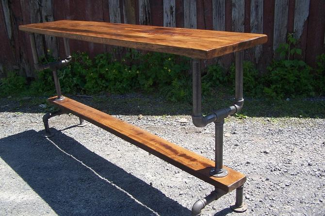 Industrial Style Bar Height Table with a Metal Pipe Base and Reclaimed Wood Plank Top by StrongOaksWoodshop