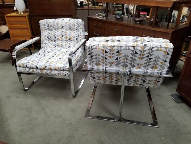 Pair of Mid-Century Modern chrome armchairs with new upholstery