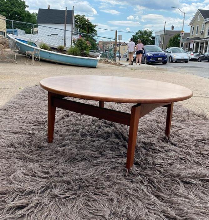 "Mid century coffee table (wear and tear) 36"" diameter x 16"" high."