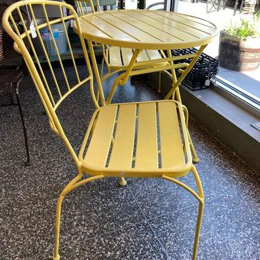 """Yellow metal 3 piece set. Table is 26"""" x 27.5"""" and folds down. Chairs are 22"""" x 17.5"""" x 33"""". Seat height is 17"""""""