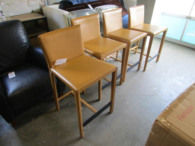 SET OF FOUR ROOM AND BOARD SAVA LEATHER COUNTER STOOLS