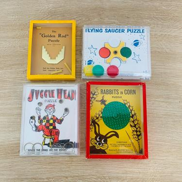 Vintage Toy Puzzles Golden Rod, Rabbits in Corn, Flying Saucer, and Juggle Head by R. Journet made in London, England - Set of 4 by DelveChicago