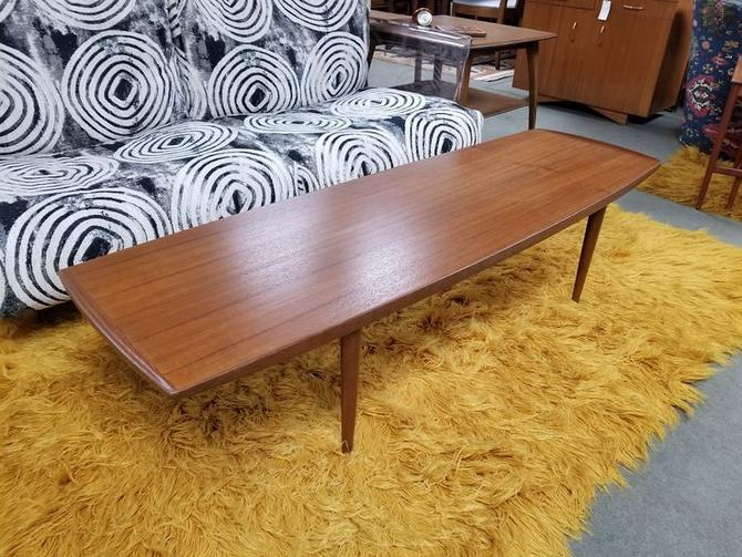 Danish Modern teak surfboard coffee table with curved edges