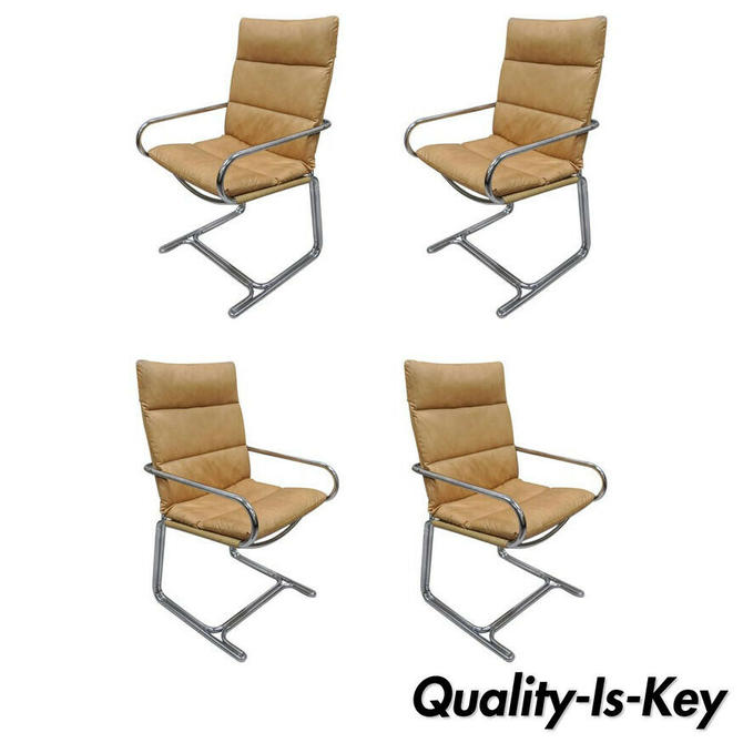 Four Tubular Chrome Cantilever Style Arm Chairs by Cosco Inc after Milo Baughman