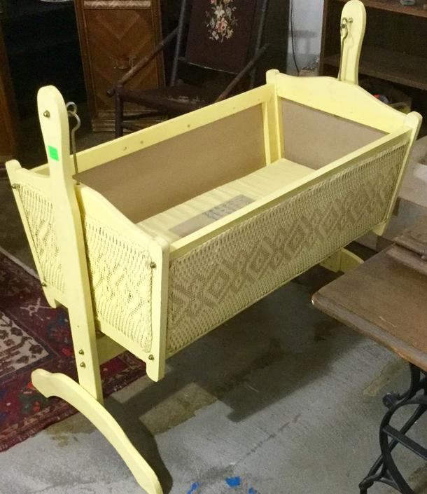 Yellow antique swinging crib available at Habitat for Humanity Restore Rockville for $20