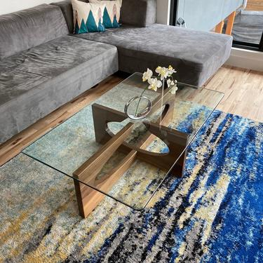 Modern coffee table with glass top by MarquardDesign