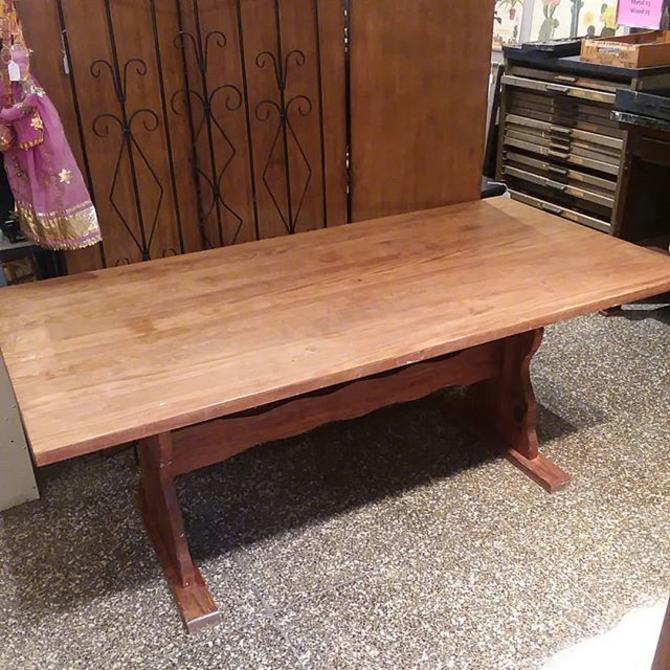 Sturdy trestle table with distressed look. Measures 72x36x30.