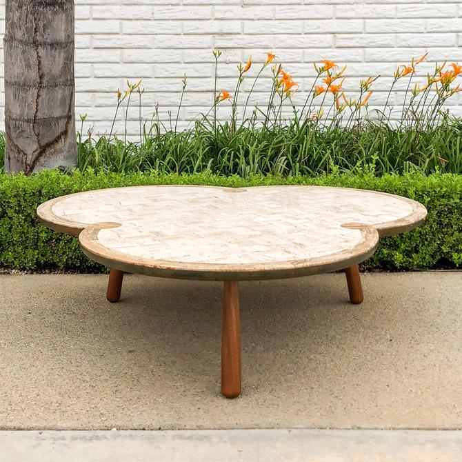 Mid Century Modern Clover Style Coffee Table with Travertine Top by VintageSupplyLA