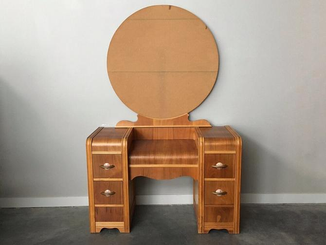 vintage art deco waterfall vanity with round mirror by F.S. Harmon